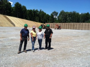 Supervisors Laura Hough and Phil Podroskey touring the pad post  construction with Jo Dee Molish and Officer Joe Sekora